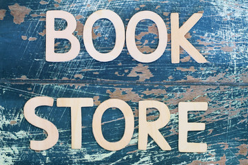 Bookstore written with wooden letters on rustic wooden surface
