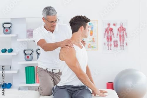 Doctor doing back adjustment - 80305678