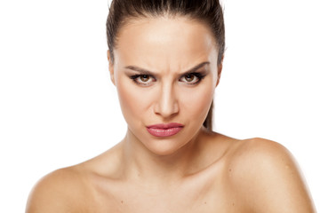 angry beautiful woman looking at you on a white background