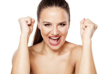 Happy beautiful woman with fist up on a white background
