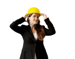 smiling female engineer with safety helmet and earplugs over whi