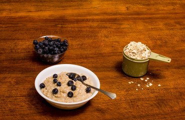 Oatmeal with Blueberries on Wood Table