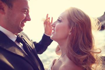 groom and bride on the beach