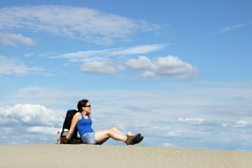 girl hiker is resting in the desert