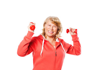 Happy senior woman making fitness training with dumbbells