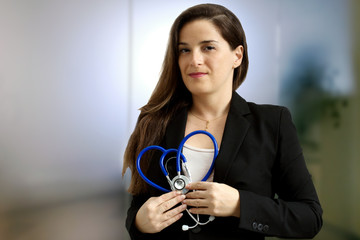 female doctor with stethoscope overmedical  background