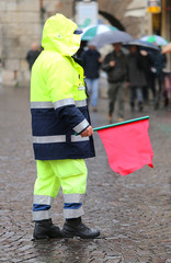 policeman with the red flag to signal the roadblock