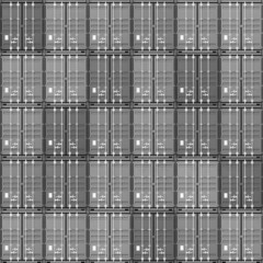Seamless texture of stacked gray cargo containers