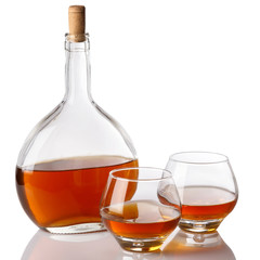 Bottle and glasses with cognac