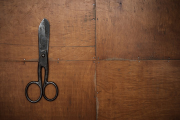old scissors on the wooden background