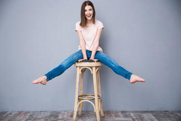 Laughing young woman sitting on the chair