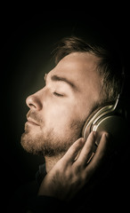 Contented young man listening to his music