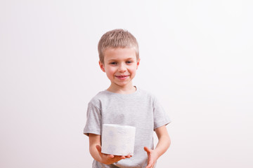 Young boy with toilet paper