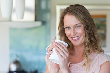 Pretty blonde holding a mug