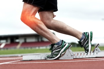Highlighted knee of man about to race