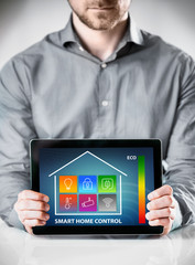 Man with Tablet Showing Home Control Display