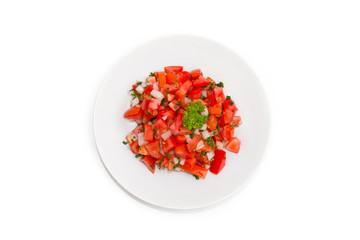 Fresh tomato salsa salad put in white dish