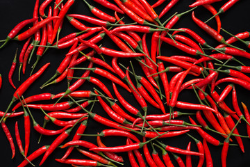 Red chilies on black background