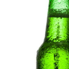 Green beer bottle with water drops over white background