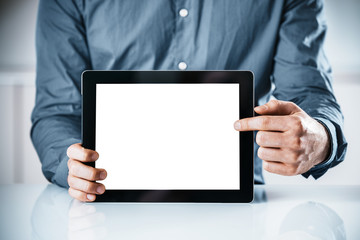 Businessman pointing to a blank tablet-pc
