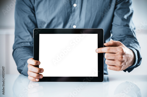 Businessman pointing to a blank tablet-pc - 80313617