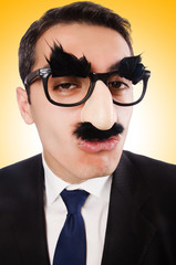 Funny businessman with eyebrows and moustache