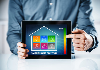 Man pointing to an interface for a smart house