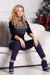 beautiful blonde  on the sofa