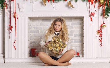 beautiful blonde woman with Christmas presents
