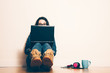 Leinwanddruck Bild - Nerd girl sitting on the floor with a laptop