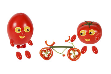 Two funny little tomatoes are with the bike