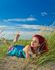 young woman on seacoast of Baltic sea