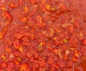 Close view of diced tomatoes with jalapenos