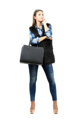 Pensive fashion woman with handbag