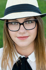 Pretty young teenage girl in dark glasses in the park