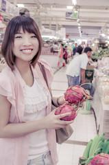 Asian tourism is choosing Pitaya fruit in Thailand open market .