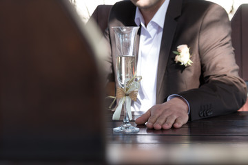 groom with a glass, wedding background