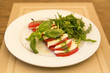 Caprese Salad - salad with tomato, mozzarella cheese and pesto s