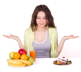 girl chooses between fruit and sweets