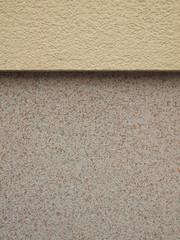 Hintergrund sanierter Haussockel mit Epoxidharzputz im Detail