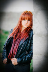 Rebellious teenager girl with red hair