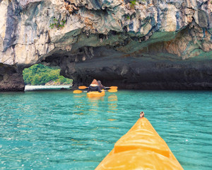 Trip on colourful kayak
