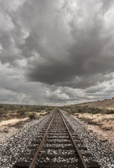 Single Railroad Track in Desert