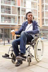 young wheelchair user relaxing with coffee.