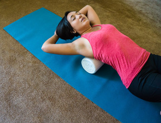woman using foam roll