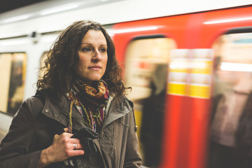 Beautiful woman in London tube with blurred train on background