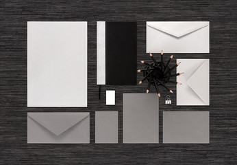 Top view of branding business mock up on black table