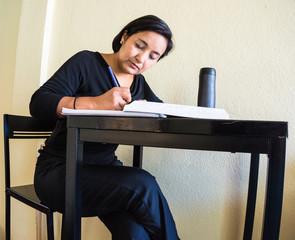 woman writing , studying