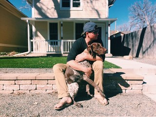 american male with dog
