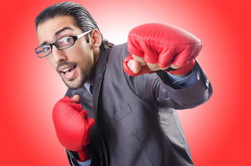 Funny businessman with boxing gloves